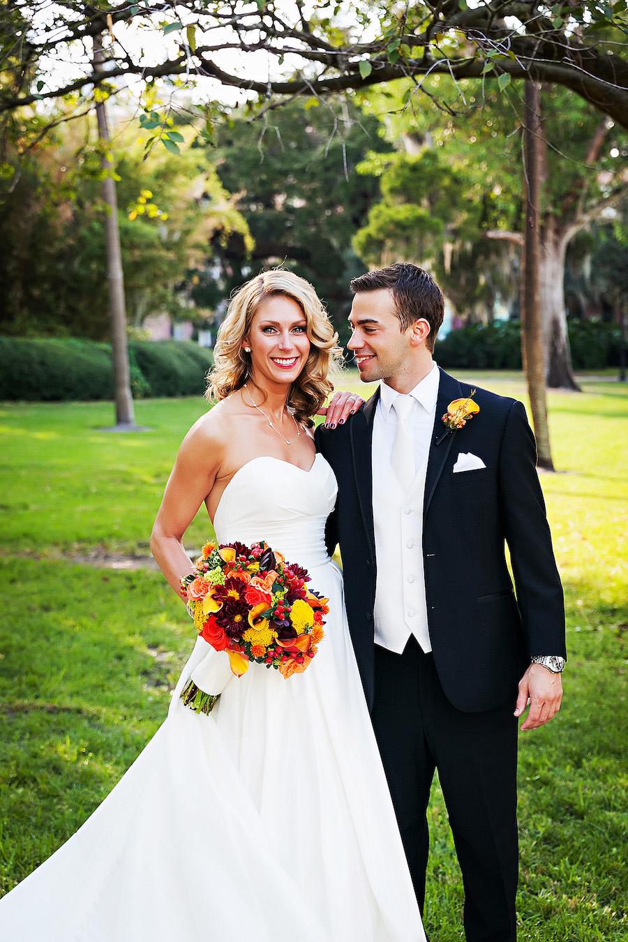 Bride and Groom with Orange, Yellow and Burgundy Wedding Bouquet Wedding Portrait   Tampa Wedding Photographer Limelight Photography