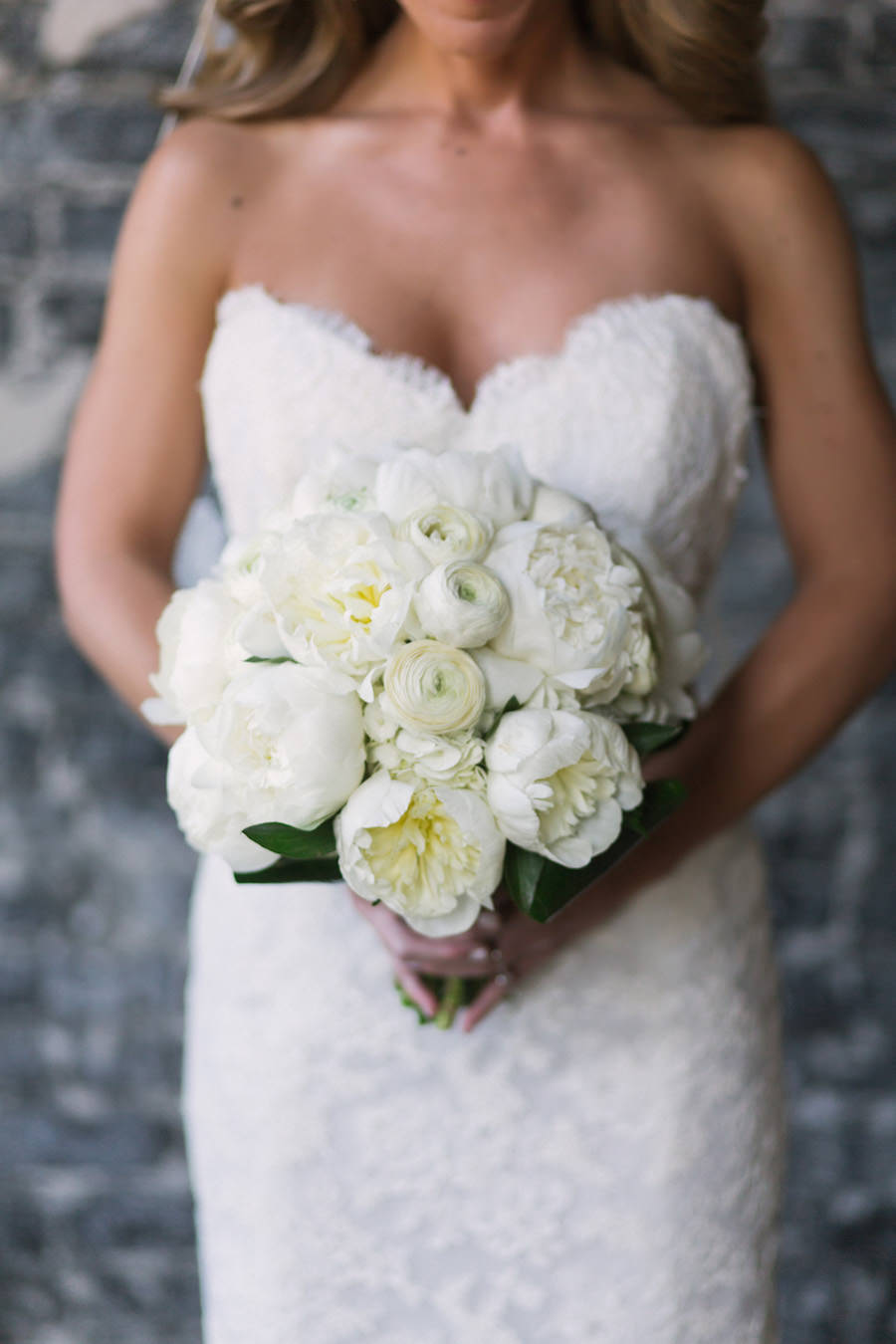 Bridal Wedding Portrait in Ivory, Lace Strapless Dress and White Floral Peony Wedding Bouquet of Flowers