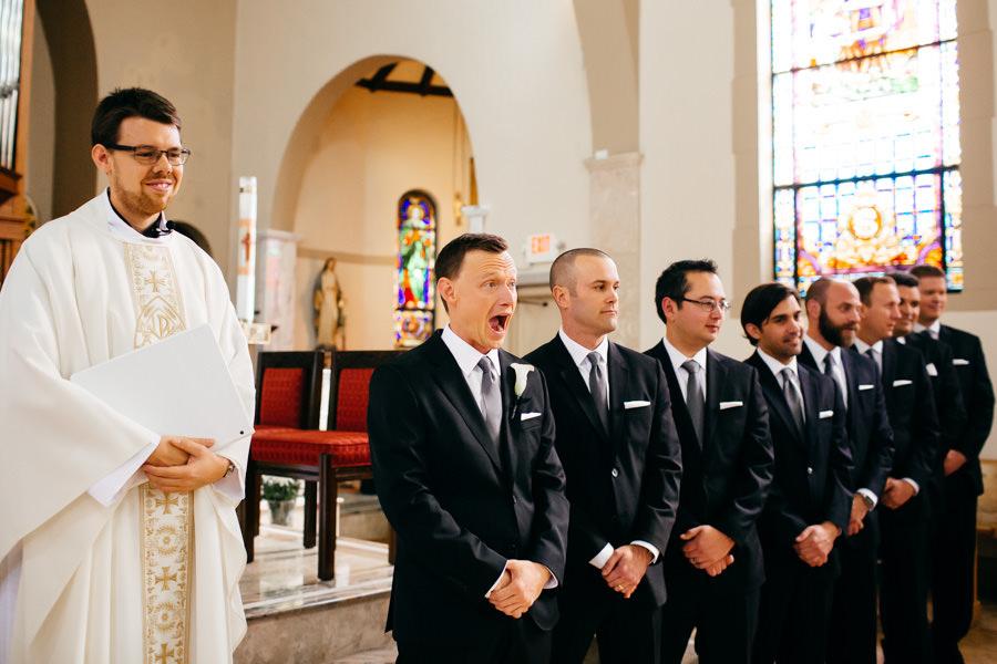 Groom Reaction to Seeing Bride Walk Down the Aisle at Sarasota Catholic Church Wedding Ceremony at St. Martha's Catholic Church