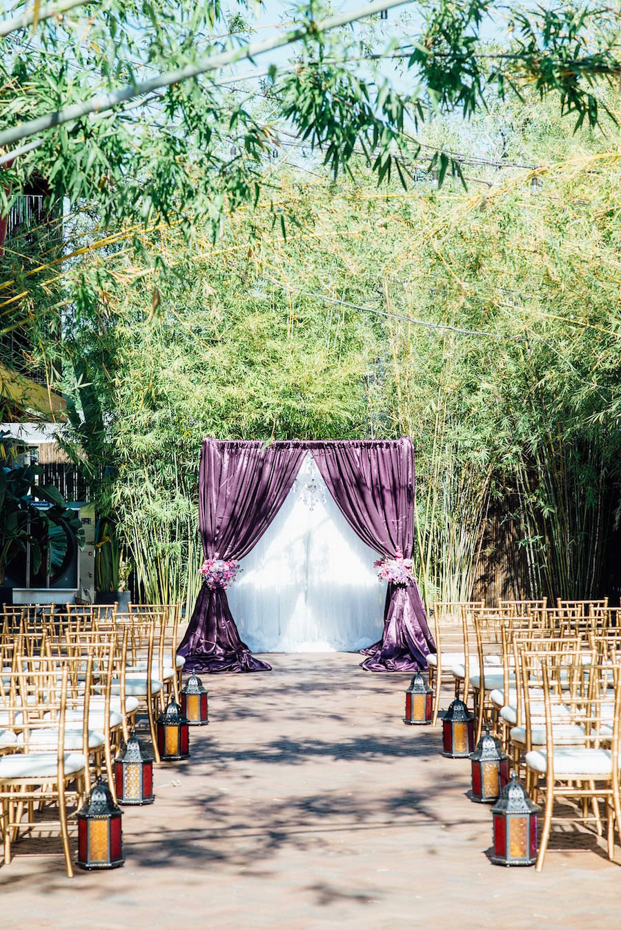 Outdoor Wedding Ceremony at St Pete Wedding Venue NOVA 535 with Purple Linen Flocked Archway and Gold Chaivari Chairs | St. Petersburg Wedding Chair Rentals ... & Outdoor Wedding Ceremony at St Pete Wedding Venue NOVA 535 with ...