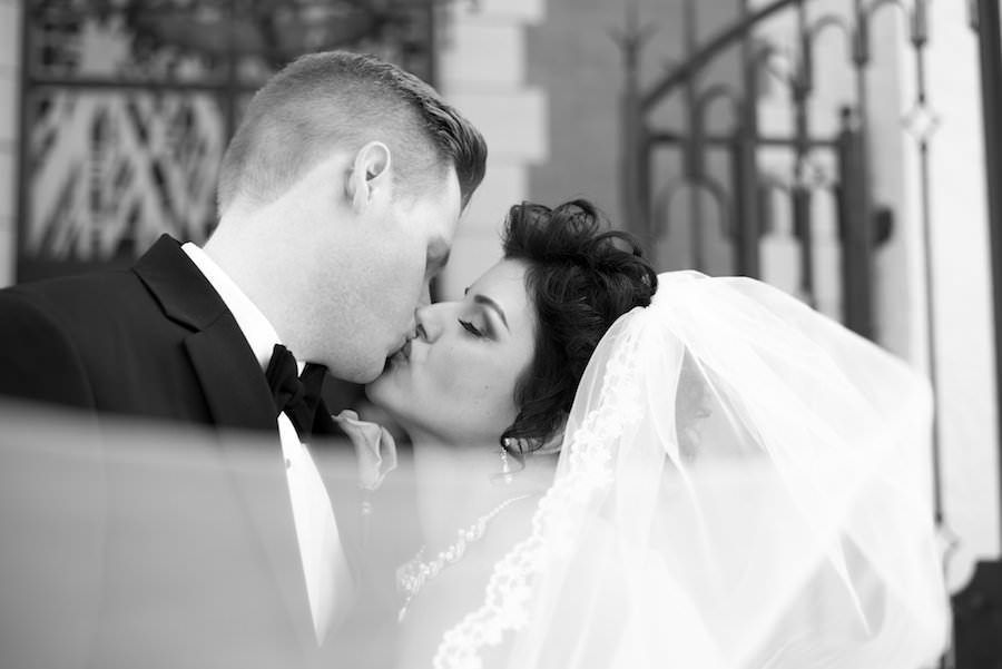 Outdoor, Tampa Bride and Groom Wedding Portrait First Kiss at Church  Tampa Wedding Photographer Caroline & Evan Photography