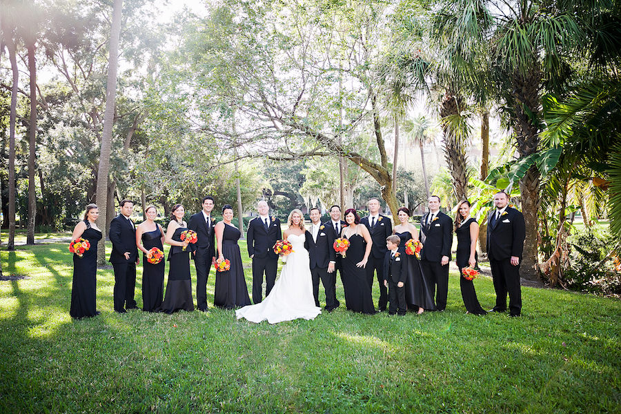 Outdoor Bridal Party Wedding Portrait with Black Bridesmaids Gowns and White, Strapless Wedding Dress with Orange and Gold Rose Bouquets   Downtown Tampa Wedding Photographer Limelight Photography