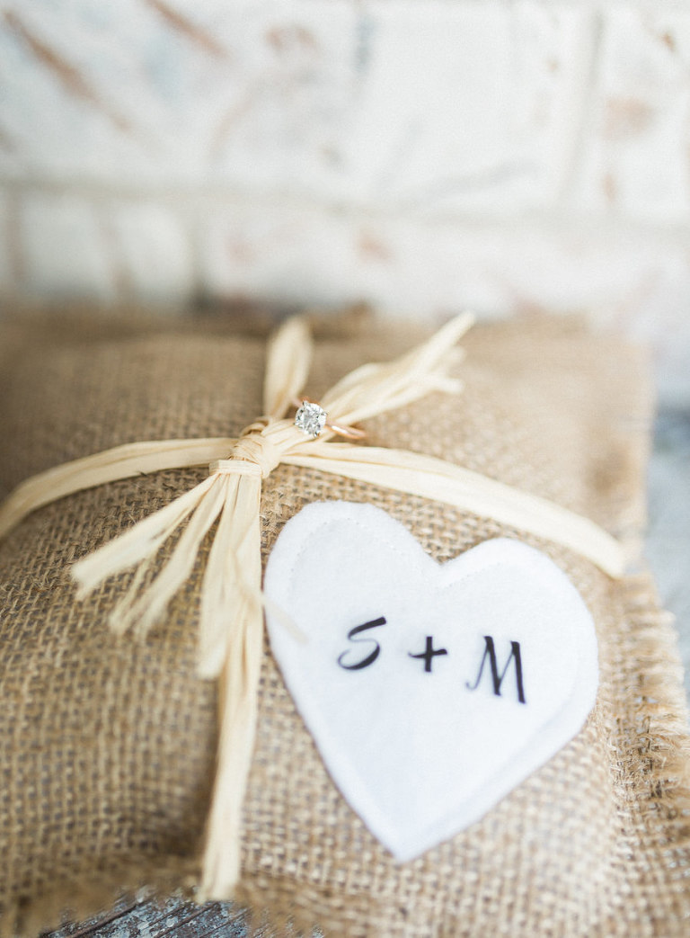 Engagement Ring Wedding Detail on Personalized Burlap Pillow with Bride and Groom Initials