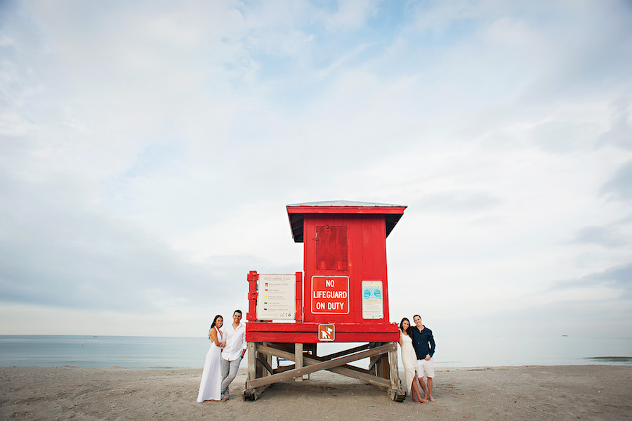 Outdoor, Waterfront Clearwater Beach Engagement Session with Lifeguard Stand   Clearwater Wedding Photographer Limelight Photography