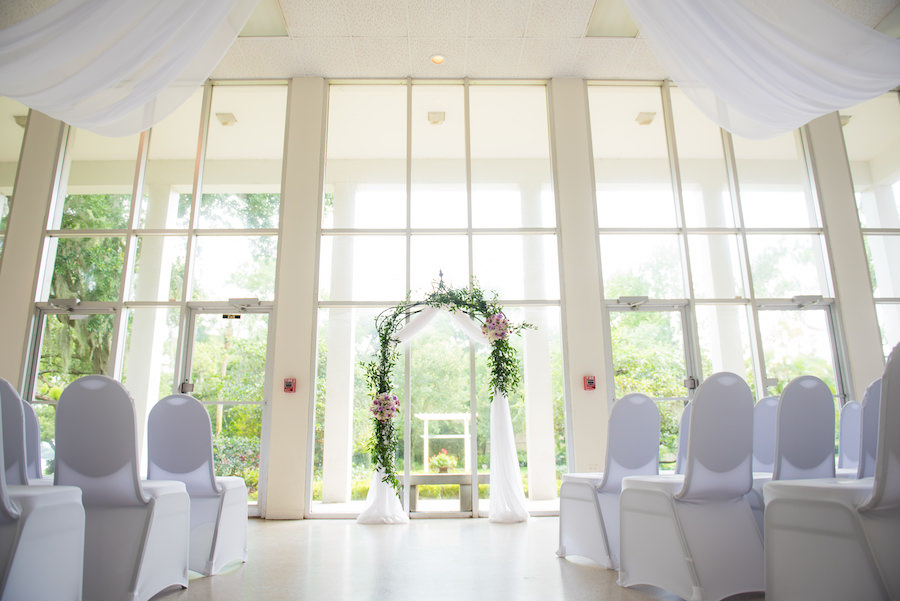 Purple, Green and White Garden Theme Wedding Ceremony at the Tampa Garden Club with White Chairs and White Tulle Ceiling Draping   South Tampa Wedding Florist Apple Blossoms Floral Design   Tampa Wedding Photographer Kera Photography