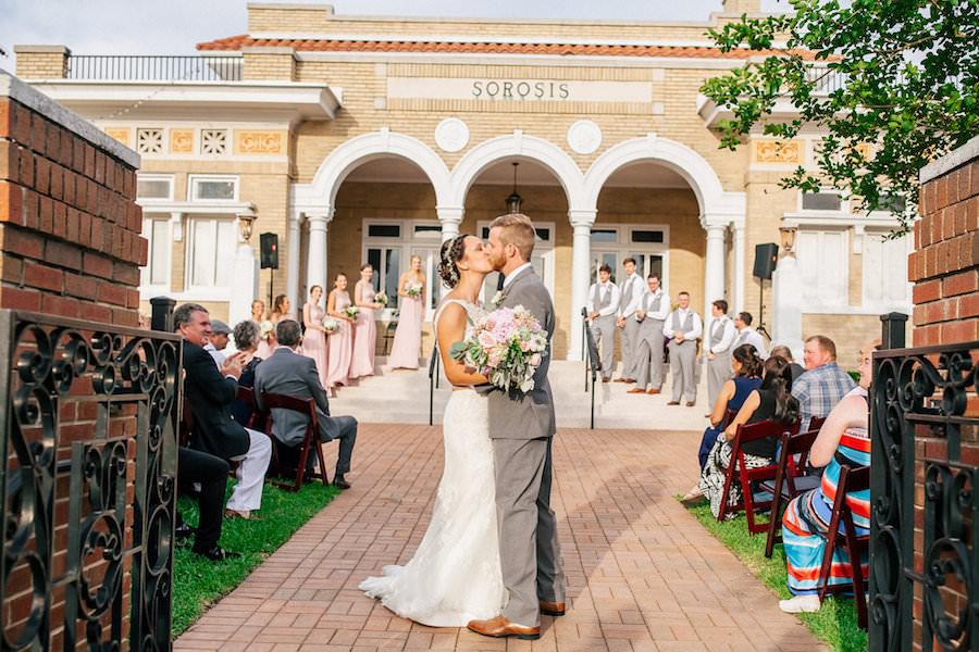 Bride and Groom Kiss at at Outdoor, Wedding Ceremony | Lakeland Wedding Venue Sorosis Building | Wedding Photographer Rad Red Creative