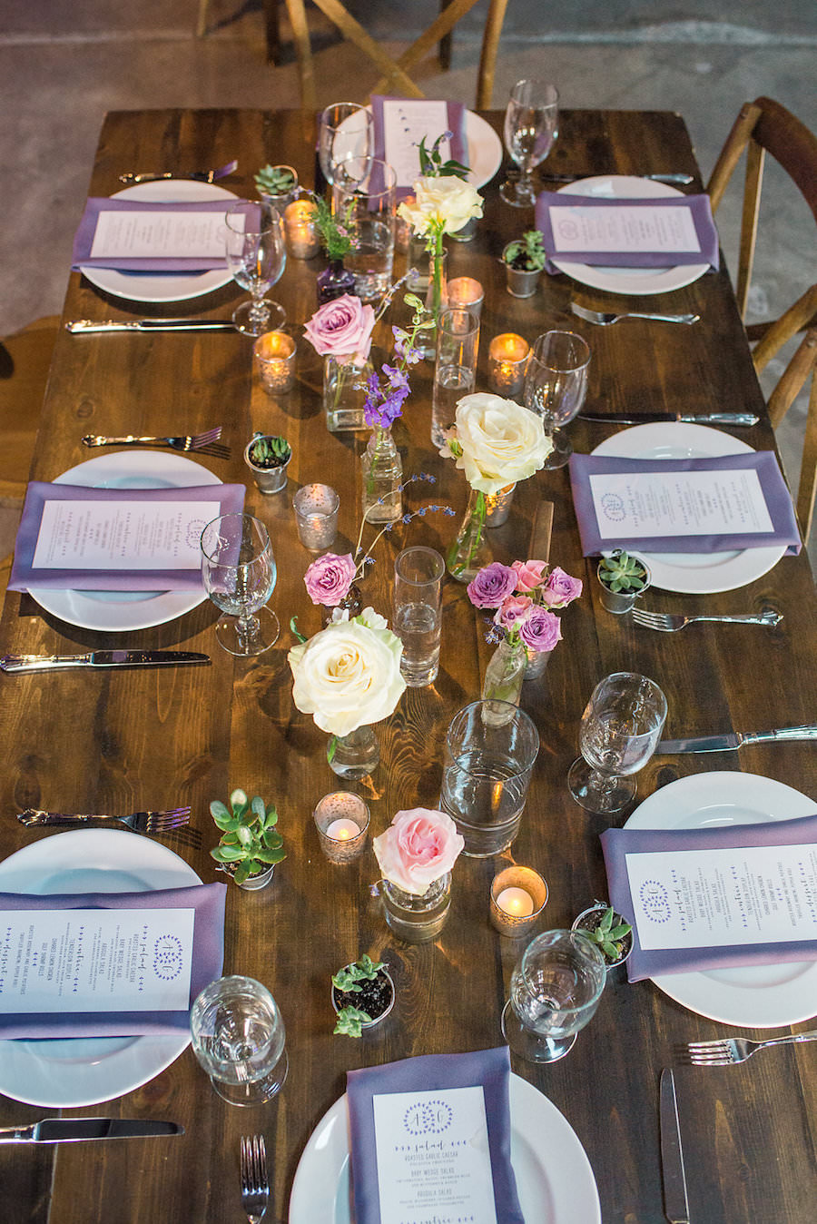 Rustic Garden Wedding Reception Table Decor with Farmhouse Table, Wooden Chairs, and Ivory and Purple Floral Centerpieces   Tampa Wedding Florist Andrea Layne Floral Designs