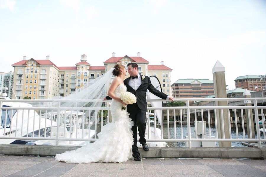 Bride and Groom Waterfront Downtown Tampa Wedding Portrait at Marriott Waterside | Wedding Bouquet by Northside Florist | Wedding Photographer Carrie Wildes Photography