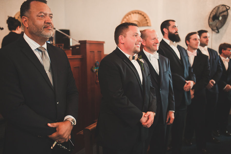 Groom's Reaction to Seeing Bride Walk Down Aisle During Wedding Ceremony