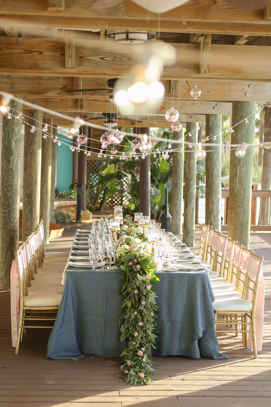 Rustic, Bohemian Beach Wedding Reception Decor with Blush, Navy and Gold Centerpieces and Gold Chiavari Chairs with Blush Satin Chair Sash at Hilton Clearwater Beach   Flowers by Iza's Flowers   Linens by Over The Top Linens   Chairs by Signature Event Rentals
