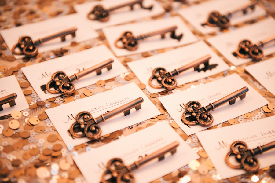 Unique Seating Chart Name Cards with Brass Key on Sequined Specialty Linen