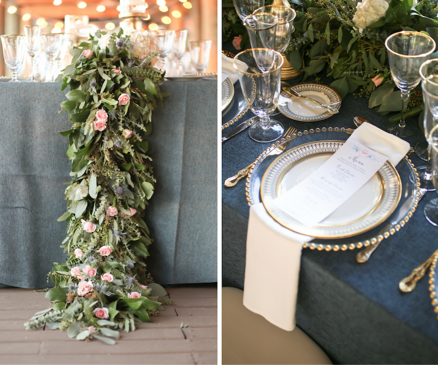 Cascading Blush Roses with Greenery Wedding Table Garland Centerpiece by Iza's Flowers   Ivory China with Art Deco-Inspired Gold Detail from A Chair Affair on Glass Beaded Charger from Signature Event Rentals and Slate Blue Burlap Linens by Over The Top Linens