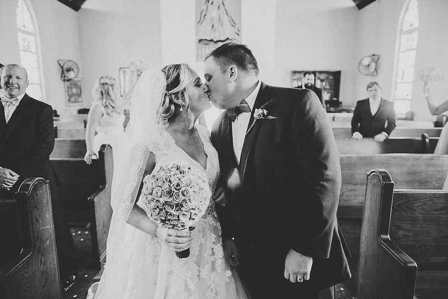 Bride and Groom Processional Kiss Wedding Ceremony Portrait at Amazing Love Ministries Ybor City