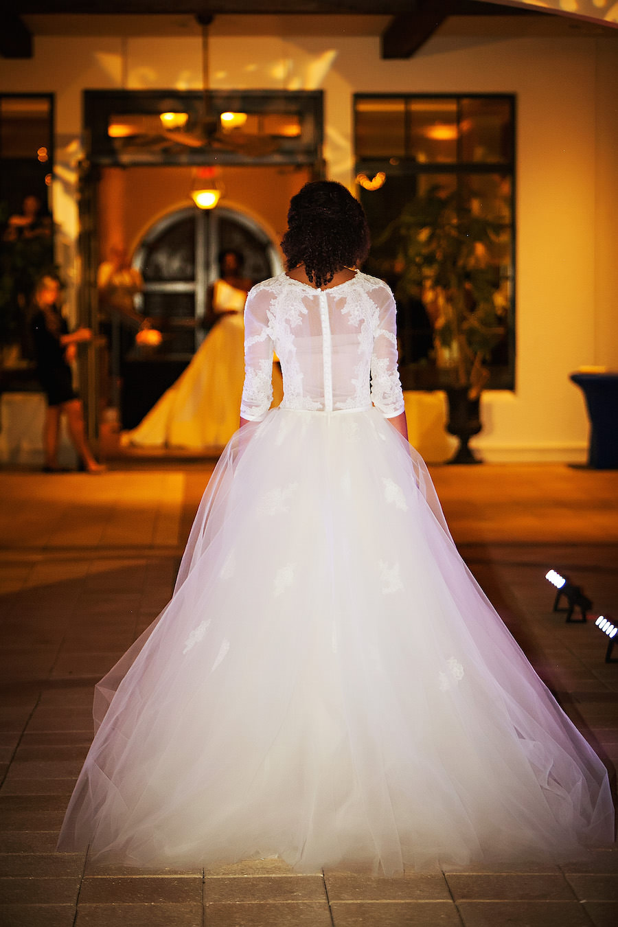 Marry Me Tampa Bay Wedding Week Fashion Show | Model in Wedding Dress with Tulle Skirt and Lace Sleeves | Tampa Bridal Salon Isabel O'Neil Bridal | Wedding Photographer Limelight Photography