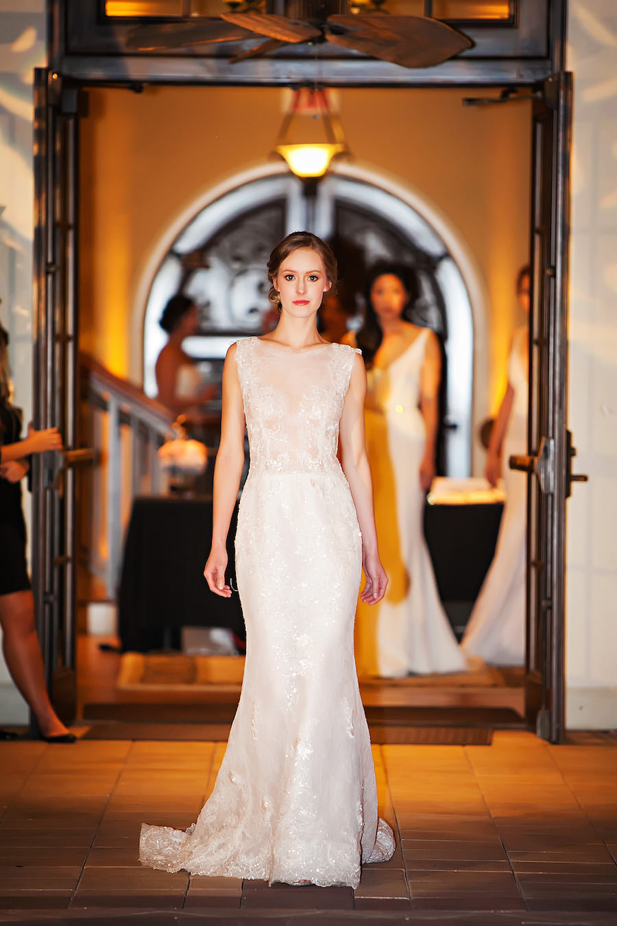 Marry Me Tampa Bay Wedding Week Fashion Show | Model in Lace Wedding Dress | Tampa Bridal Salon Isabel O'Neil Bridal | Wedding Photographer Limelight Photography