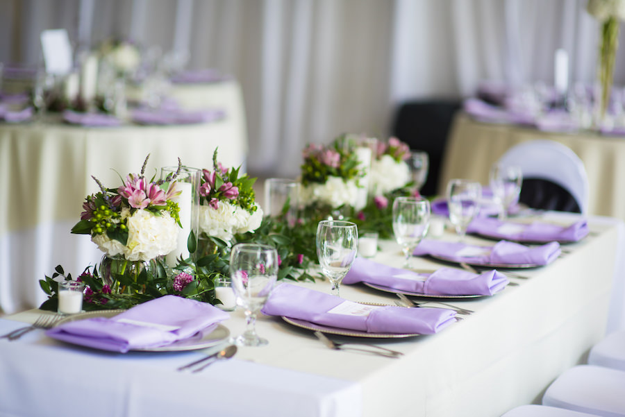 Green Purple And Ivory Wedding Centerpieces On Feasting Tables