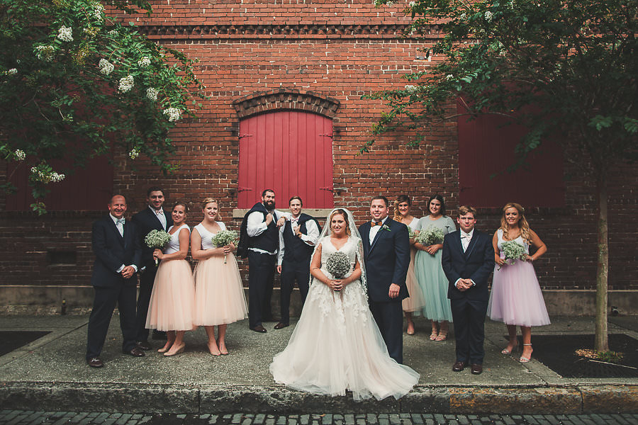 Bridal Party Wedding Portrait with Tulle Bridesmaids Skirts from Studio46Boutique in Tampa Florida and Allure Cap Sleeve Tulle and Lace Wedding Gown | Ybor City Wedding