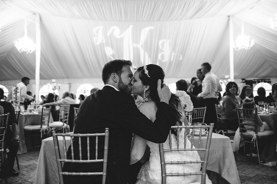 Bride and Groom Wedding Portrait Tented Reception with Monogram GOBO Lighting   Sarasota Wedding Planner NK Productions