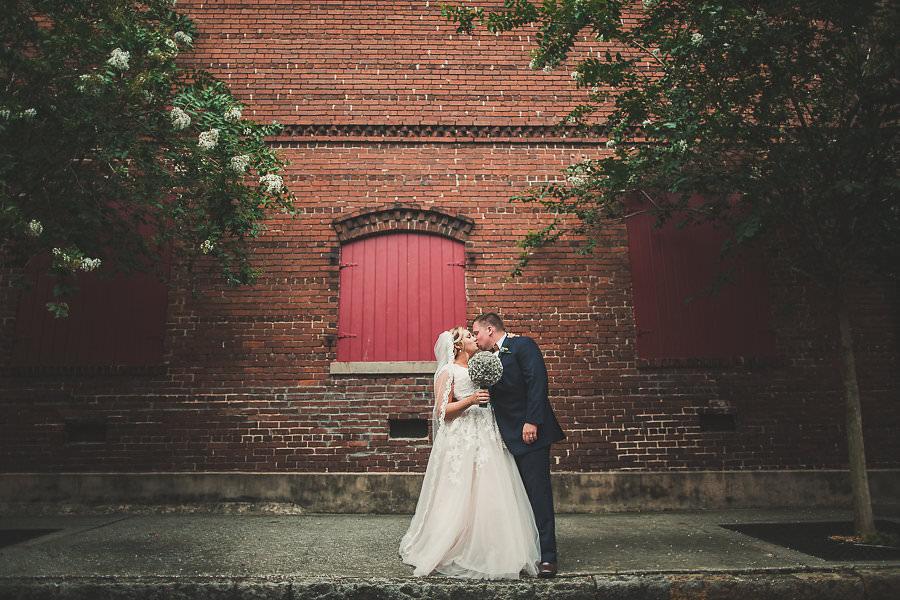 Outdoor Bridal Wedding Portrait in Lace and Tulle Wedding Dress with Paper Flower Wedding Bouquet | Historic Ybor City Tampa Wedding