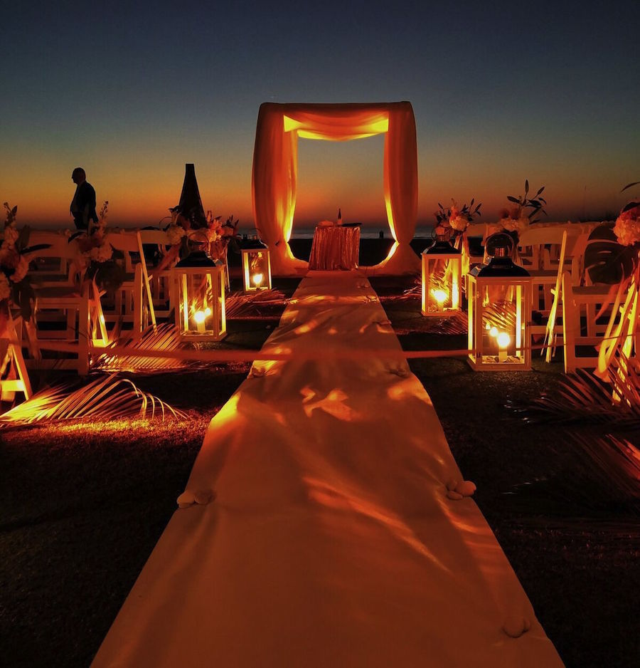 Outdoor Amber Lighting for Wedding Ceremony Aisle by Nature Coast Entertainment Services