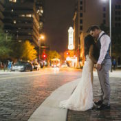 Downtown Tampa Bride and Groom Wedding Portrait in Gray Suit and Ivory Lace Ines DiSanto Wedding Dress from Isabel O