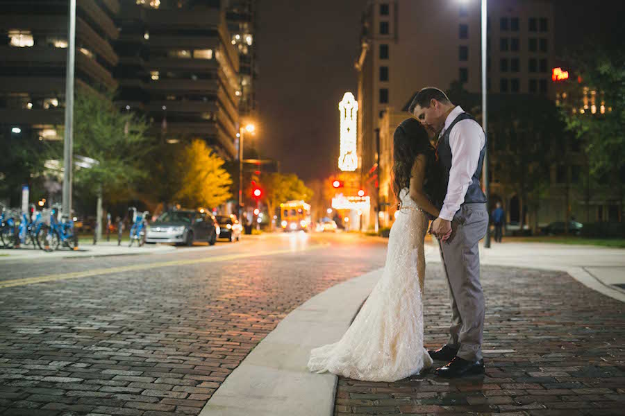 Downtown Tampa Bride and Groom Wedding Portrait in Gray Suit and Ivory Lace Ines DiSanto Wedding Dress from Isabel O'Neil Bridal Collection   Tampa Wedding Photographer Roohi Photography