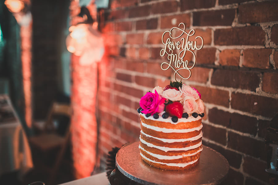 """Round Naked Wedding Cake with Fresh Berries and Pink Roses with """"Love You More"""" Cake Topper 