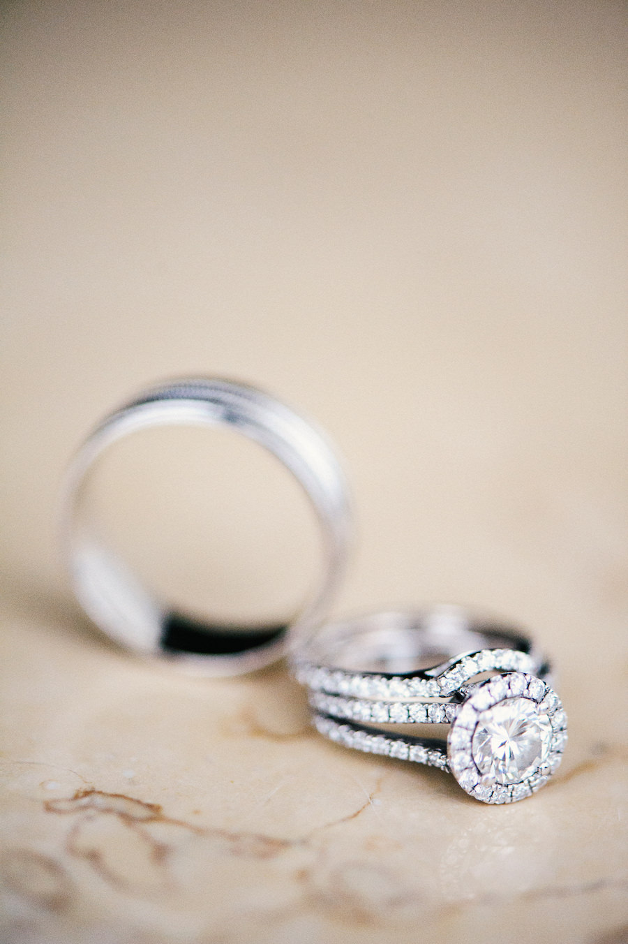 Bridal Wedding Band and Princess Cut Engagement Ring with Halo on Marble