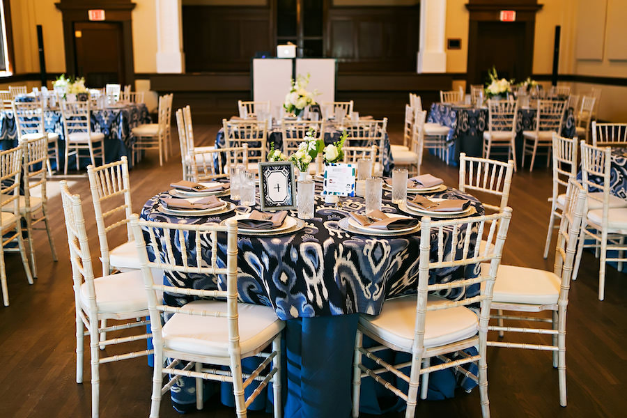 White Chiavari Chairs and Navy Blue Linens   Rentals by A Chair Affair and Over the Top Rental Linens Lakeland Wedding Venue Junior League Sorosis Building
