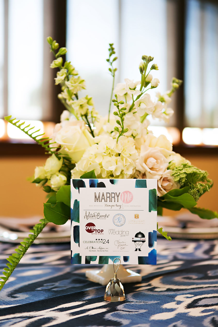 Tampa Bay/Lakeland/Sarasota Wedding Networking Event   White Wedding Floral Centerpiece with Hydrangeas, Pink Roses and Greenery and Navy Blue Linens   Over the Top Linen Rentals