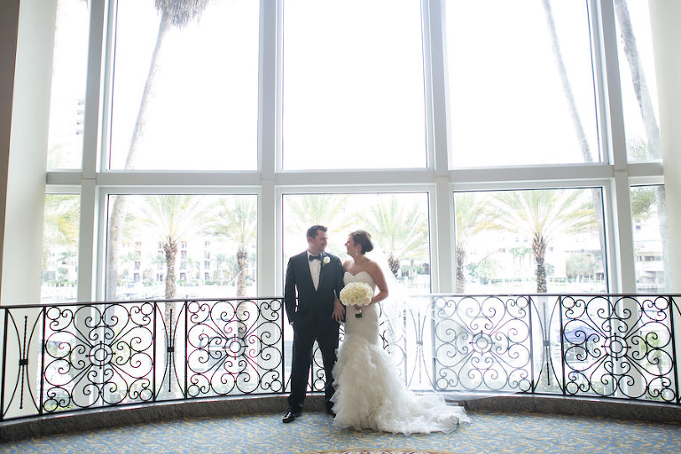 Downtown Tampa Bride and Groom Wedding Portrait at Marriott Waterside | Bride's Wedding Bouquet by Northside Florist | Wedding Photographer Carrie Wildes Photography