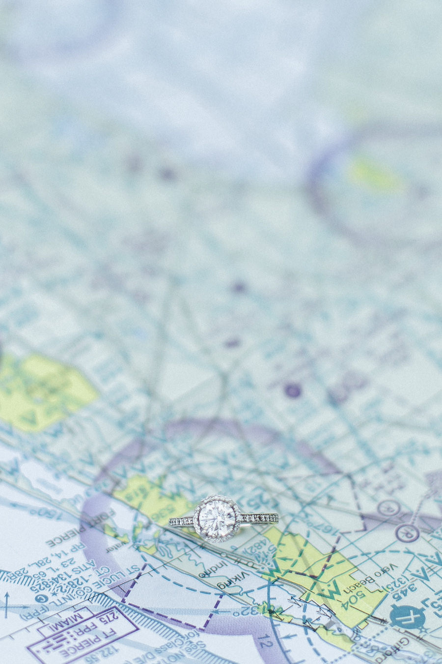 Travel Inspired Engagement Ring Portrait with Map   Lakeland Wedding and Engagement Photographer Ailyn La Torre Photography