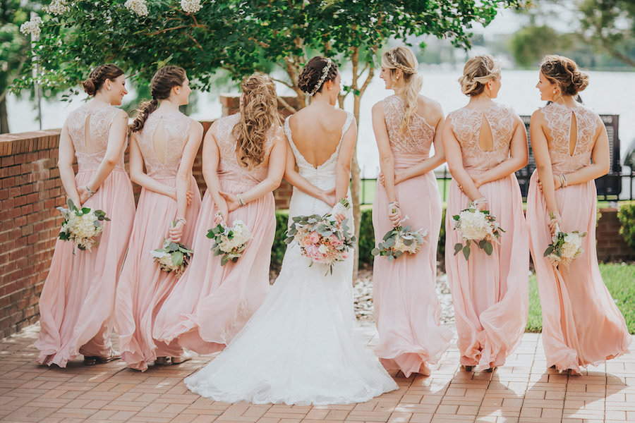 Outdoor, Bride and Bridesmaids Wedding Portrait in Pink Jim Hjelm Bridesmaids Dresses and Lacy, Ivory Wedding Dress | Tampa Bridesmaids Dress Shop Bella Bridesmaid