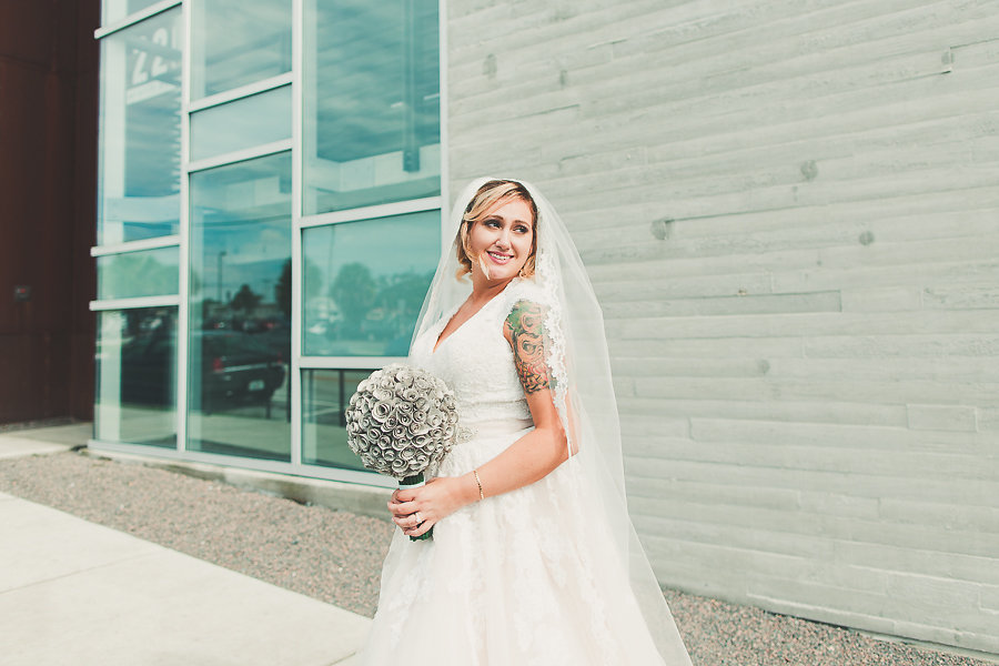 Bridal Wedding Portrait in Ivory Allure Cap Sleeve Tulle and Lace Wedding Dress with Eco Friendly Paper Flower Wedding Bouquet and Cathedral Veil