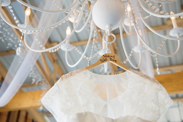 Ivory, Lace Wedding Dress Hung on Chandelier