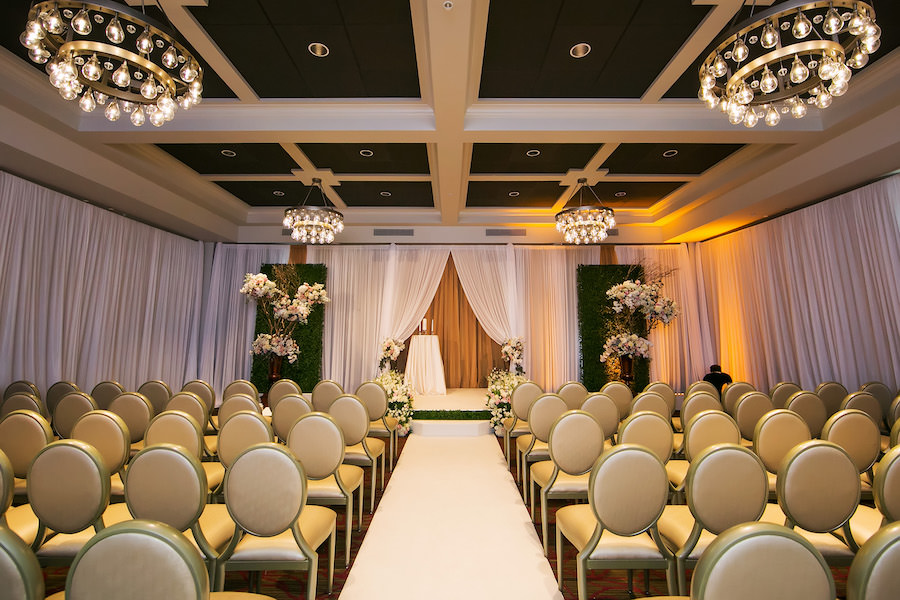 Indoor Wedding Ceremony with Large Manzanita Trees, Rose Floral Arrangements and Rose-Lined Altar with White Pipe and Drape   St. Petersburg Wedding Photographer Limelight Photography