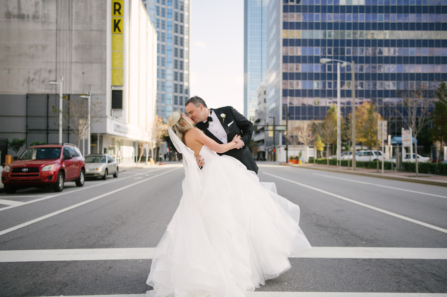 Downtown Tampa Bride and Groom Wedding Portrait in Black Tuxedo and White Strapless Sweetheart Hayley Paige Wedding Dress