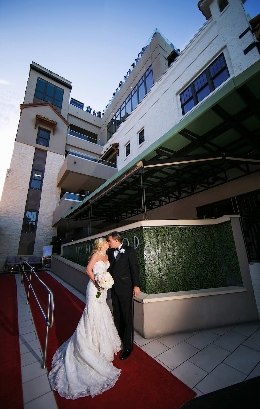 Downtown St. Petersburg Bride and Groom Wedding Portrait in Black Tuxedo and Ivory and Silver Allure Couture Wedding Dress with Ivory Floral Wedding Bouquet at St. Pete Wedding Venue The Birchwood   Photography by Limelight Photography