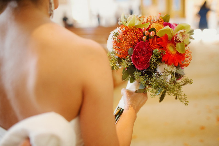 Bridal Wedding Day Portrait with Strapless Wedding Gown and Red and Orange Bouquet | Sarasota Wedding Planner Jennifer Matteo Events