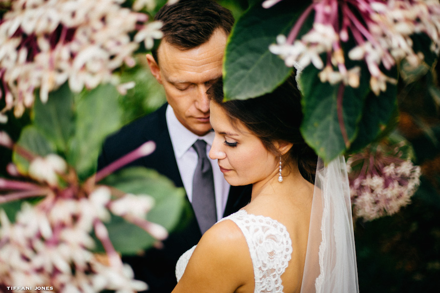 Outdoor Bride and Groom Wedding Day Portrait with Flowers and Lace Wedding Dress | Sarasota Wedding Planner Jennifer Matteo Events