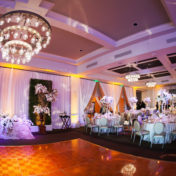 Traditional Wedding Reception with Centerpieces of Pink and Ivory Roses and Orchids on Custom Lace Table Linens | Specialty Linens by Over The Top Linens | Glassware and China by A Chair Affair | St. Petersburg Wedding Photographer Limelight Photography