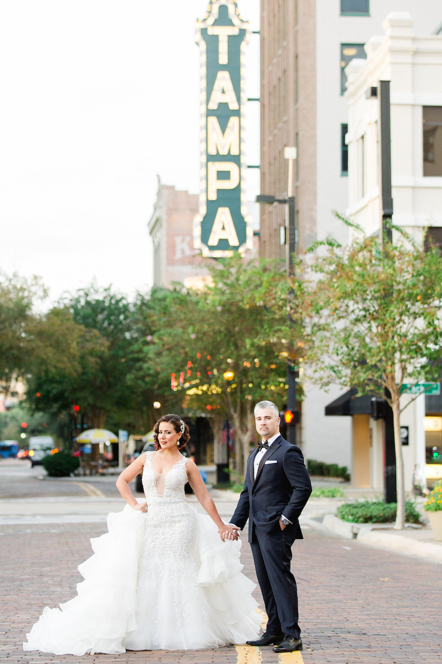 Outdoor, Downtown Tampa Wedding Portrait with Tampa Theatre Sign | Bride in Ivory Mermaid Ines DiSanto Wedding Dress from Isabel O'Neil Bridal | Liana Fuente Wedding Portrait | Tampa Wedding Photographer Ailyn La Torre Photography