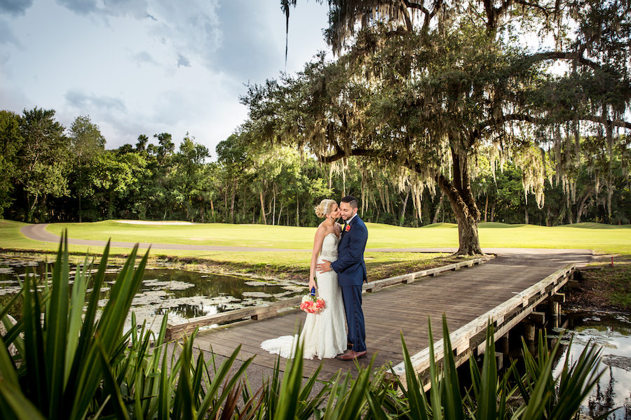 Bride and Groom Wedding Portrait on Boardwalk Overlooking Lake at Tampa Wedding Venue Tampa Palms Golf and Country Club