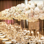Wedding Reception Table Decor with Tall, Glass Pink and Ivory Floral Centerpieces, Candlelight, and Gold Sequined Table Linens | Elegant, Romantic Wedding Reception Inspiration ideas