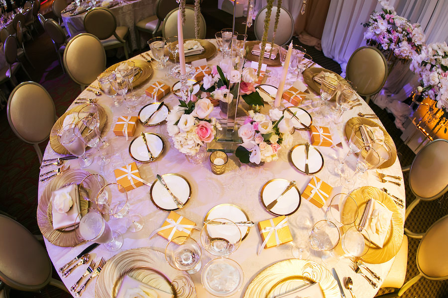 Gold and Ivory Wedding Reception Table Decor with Gold Chargers, Gold Satin Napkins and Tall Wedding Centerpieces on Custom Lace Linens   St. Petersburg Linen Rentals by Over The Top Linens   Glassware, China and Flatware by A Chair Affair   Photography by Limelight Photography