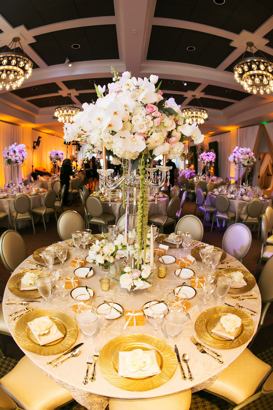 Gold and Ivory Wedding Reception with Gold Chargers, Gold Satin Napkins and Tall Wedding Centerpieces with Pink and Ivory Roses   St. Petersburg Linen Rentals by Over The Top Linens   Glassware, China and Flatware by A Chair Affair   Photography by Limelight Photography