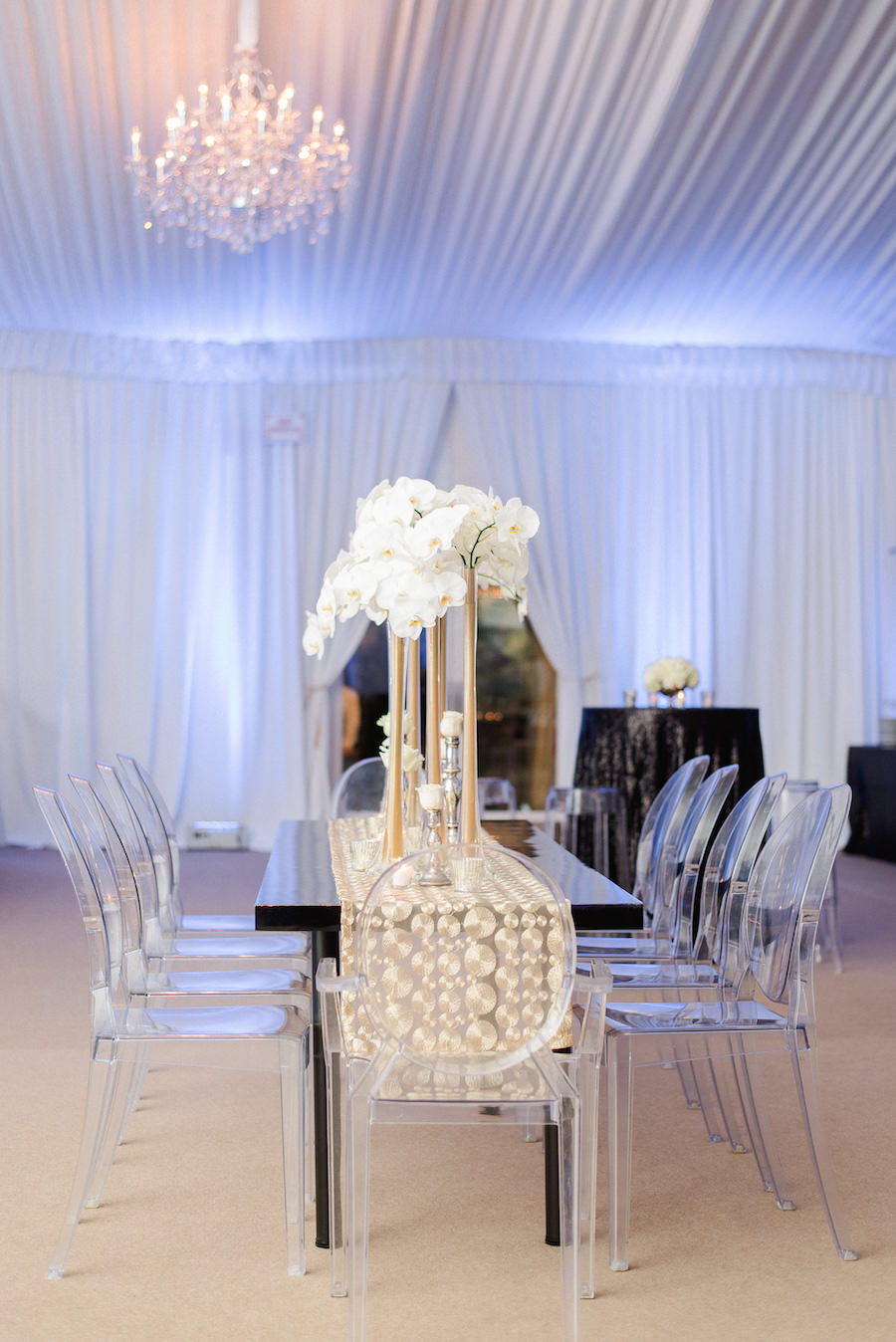 White and Gold Wedding Reception Décor with Tall, White Orchid Centerpieces on Gold Table Runners by Connie Duglin Linens and Lucite Chairs | Wedding Flowers by Andrea Layne Floral Design | Downtown Tampa Wedding Photographer Ailyn La Torre Photography