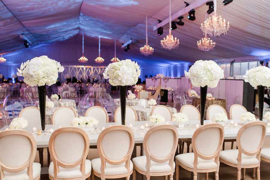 Wedding Reception Décor with Tall, White Hydrangea and Orchid Centerpieces on Long, White Feasting Tables | Wedding Flowers by Andrea Layne Floral Design | Downtown Tampa Wedding Photographer Ailyn La Torre Photography