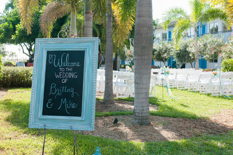 Blue St. Petersburg Welcome Sign at Waterfront Beach Wedding