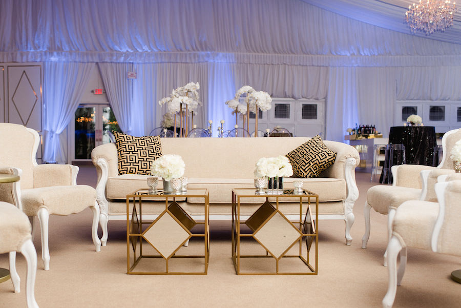 Elegant, Tented Wedding Reception with White Floral Centerpieces and Ivory Sofas | Flowers by Andrea Layne Floral Design | Downtown Tampa Wedding Photography by Ailyn La Torre Photography